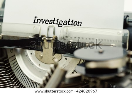 Investigation - Paper Sheets in Old Vintage Typewriter . Business concept on Toned, Grain Effect, Shallow Depth Of Field and Blurred Background - stock photo