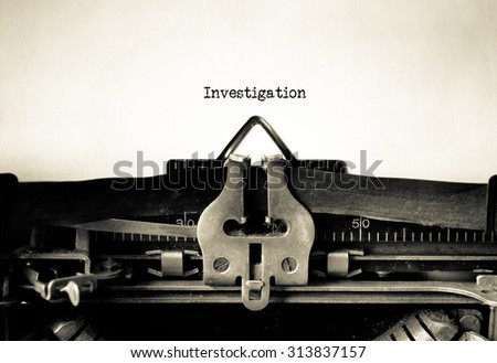 Investigation word typed on a Vintage Typewriter.   - stock photo