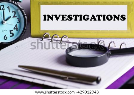 Investigations - Yellow Office Folder on Background of Working Table with Magnifying glass, a pen and clock -business and finance concept - stock photo