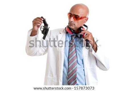 Investigator processing a hand gun - stock photo