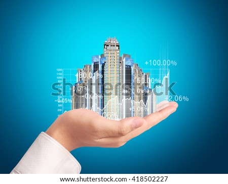 Investment concept, businessman with financial symbols coming from hand - stock photo