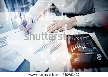 Investment manager working process.Concept photo trader work market report modern tablet.Using electronic device.Graphic icons,stock exchange reports screen interfaces.Business startup.Film effect - stock photo