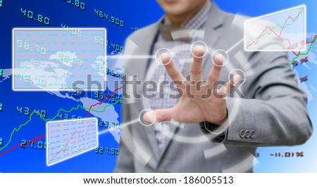 Investor analyzing data with touch screen computer - stock photo