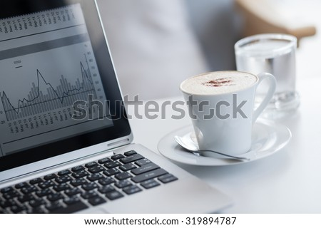Investor trading on the laptop. - stock photo