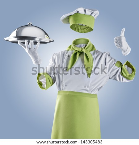 invisible chef with restaurant cloche or tray on a blue background - stock photo