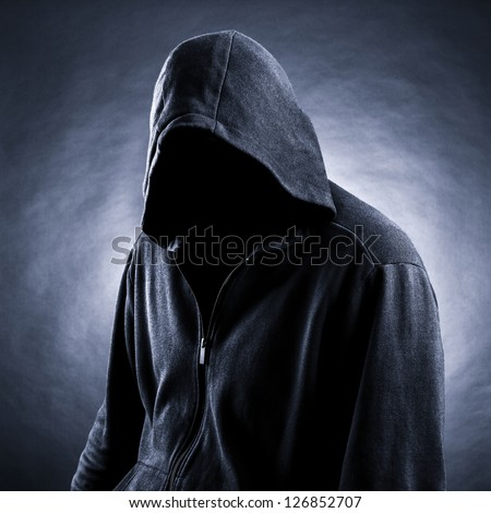 Invisible man in the hood.  Black  background. - stock photo