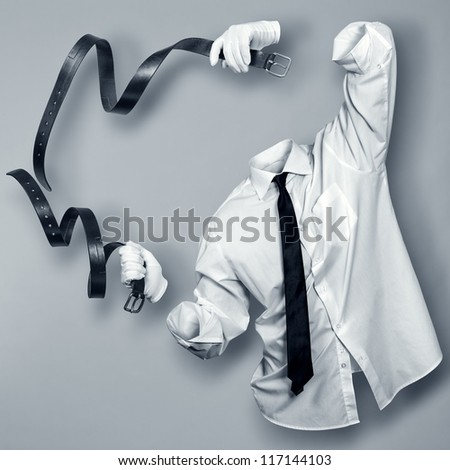 Invisible Man with two leather straps in the hands of - stock photo