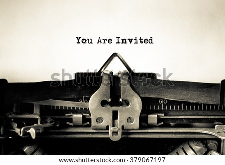 Invitation message typed on vintage typewriter - stock photo
