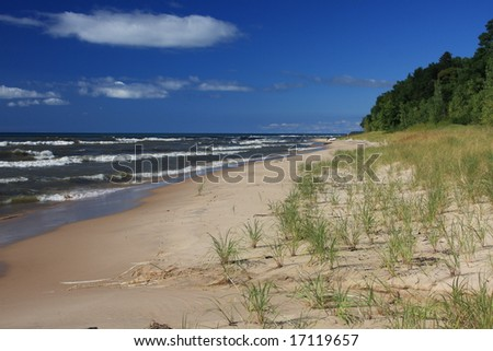 Inviting beach on Lake Michigan - stock photo