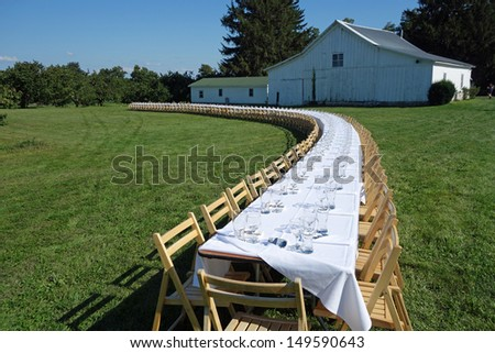 Inviting table setting for an outdoor dinner on the farm - stock photo