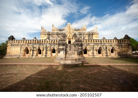 INWA,MYANMAR - JULY 1: Maha Aung Mye Bon Zan or The brick Monastery is one of the finest brick building decorated with flora and stucco on July 1,2014 in Inwa ancient city,Mandalay State,Myanmar. - stock photo