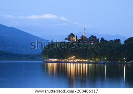 Ioannina city in Greece. View of the lake and the mosque - stock photo
