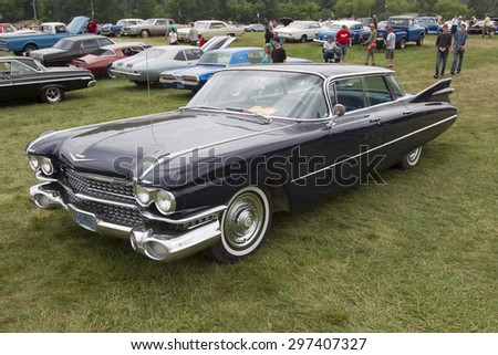 IOLA, WI - JULY 12:  Side of 1959 Cadillac Flat Top Car at Iola 42nd Annual Car Show July 12, 2014 in Iola, Wisconsin. - stock photo