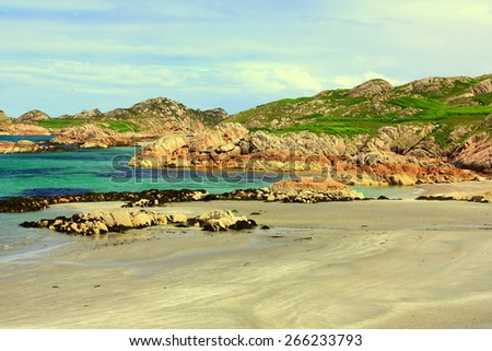 Iona is a small island in the Inner Hebrides off the Ross of Mull on the western coast of Scotland.  - stock photo
