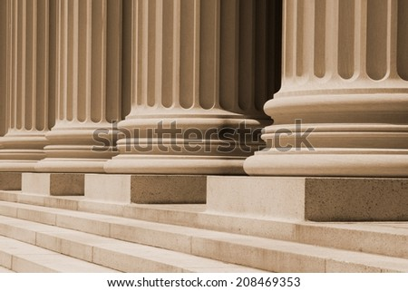 Ionic columns at a court house. - stock photo