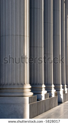 Ionic columns in front of a bank. - stock photo