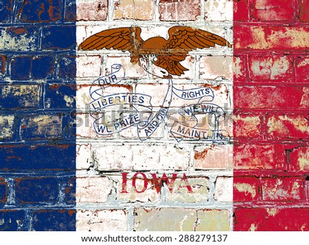 Iowa state flag of America on brick wall - stock photo
