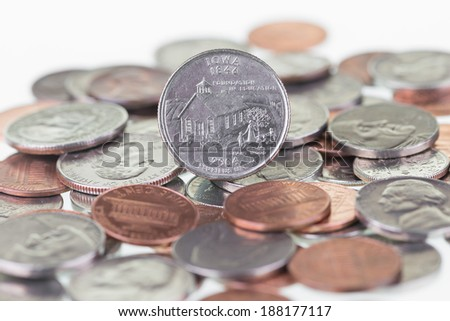 Iowa State Quarter with other coins extreme close up - stock photo