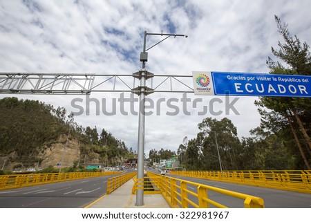 IPIALES, COLOMBIA, MARCH 2: Road border between Ecuador and Colombia with sign road stop. Ecuador 2015 - stock photo