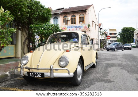 IPOH, MALAYSIA - 24 NOV, 2015: Classic VW Beetle parked on the roadside of Ipoh town, Malaysia. Ipoh is one of historical town in Malaysia. - stock photo