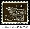 """IRELAND-CIRCA 1971: A stamp printed in IRELAND shows image of """"Dog"""" part of an old Irish decorative brooch, circa 1971. - stock photo"""