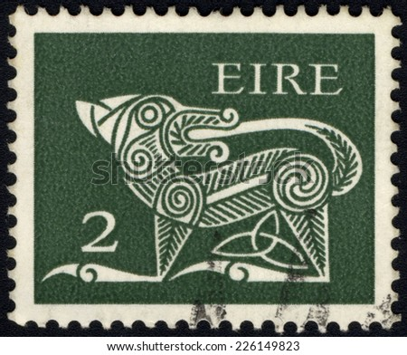 IRELAND-CIRCA 1971: A stamp printed in Ireland  shows image of Dog part of an old Irish decorative brooch, circa 1971. - stock photo