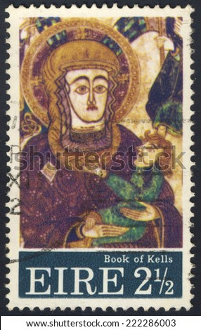 IRELAND - CIRCA 1972: A stamp printed in Ireland shows Madonna and Child, Christmas, the Design is after a Miniature in the Book of Kells, 9th Century, circa 1972 - stock photo
