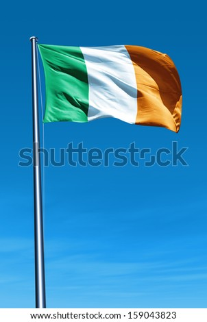 Ireland flag waving on the wind - stock photo