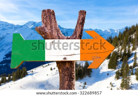 Ireland flag wooden sign with winter background - stock photo