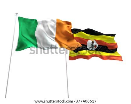 Ireland & Uganda Flags are waving on the isolated white background - stock photo