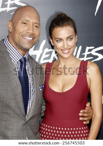 "Irina Shayk and Dwayne Johnson at the Los Angeles premiere of ""Hercules"" held at the TCL Chinese Theatre in Los Angeles on July 23, 2014 in Los Angeles, California.  - stock photo"