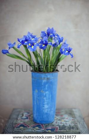 Iris flowers in a vase. - stock photo