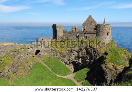 Irish castle of Dunluce on the coastal scenic road . Northern Ireland - stock photo
