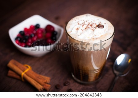 Irish coffee in simple glass with fruits - stock photo
