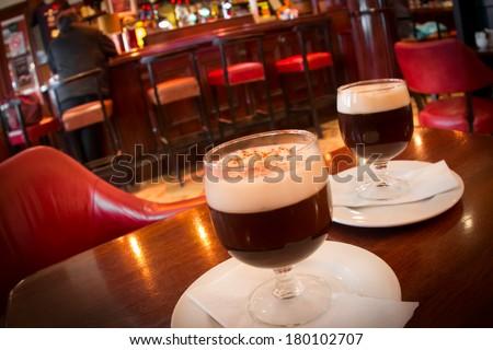 Irish coffee in traditional Irish pub setting - stock photo
