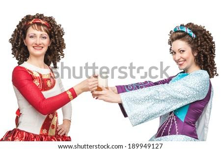 Irish dancers with mug of beer - stock photo