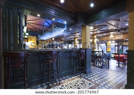 Irish pub interior tiled floor - stock photo