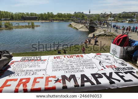 IRKUTSK, RUSSIA - MAY 25: The Really, Really Free Market organized on embankment in Siberian city Irkuts on 25 of May 2014, Russia - stock photo