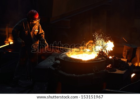 Iron and steel factory worker - stock photo