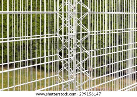 Iron bars of an empty gabion wall - stock photo