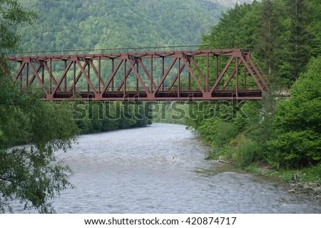 Iron bridge over the Tisza River. Transcarpathia - stock photo