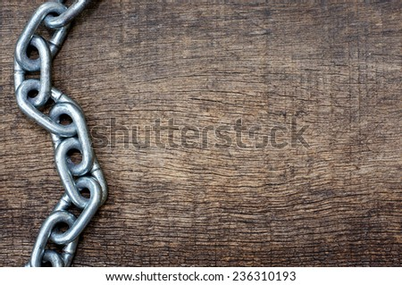 iron chains forming waves in the background wood texture for themes - stock photo