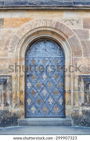 iron door of the church - stock photo