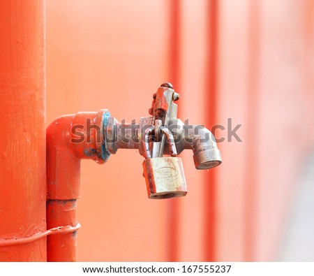 iron faucet water with lock - stock photo