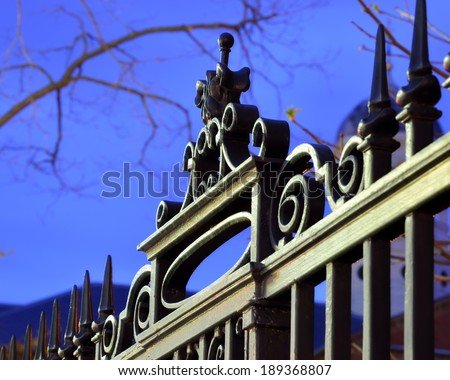 Iron fence detail, dusk sky - stock photo