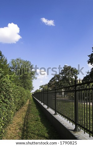 Iron Fence in Summer Park in Saint Petersburg, Russia - stock photo