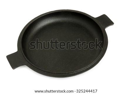 Iron frying pan isolated on white background - stock photo