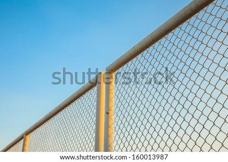 iron hain fence with sky background - stock photo