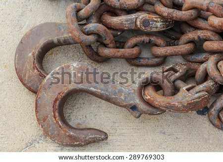 iron hook and chain line on the floor in close up - stock photo