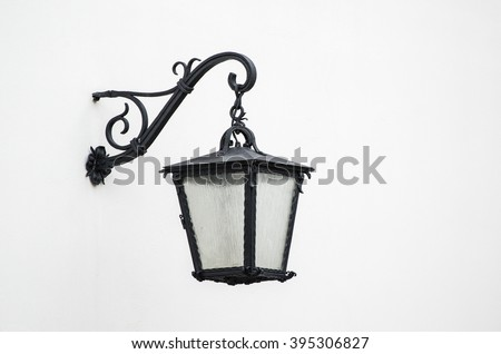 Iron lantern against the white wall - stock photo
